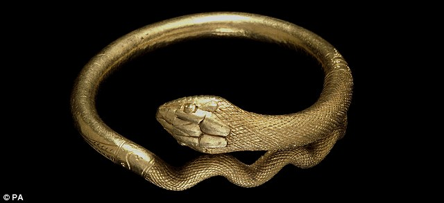A gold bracelet in the form of a coiled snake