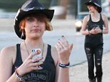 Rockabilly jeans! Paris Jackson dons cowboy outfit with ripped denim and Stetson hat as she strolls outside her mother's rural home