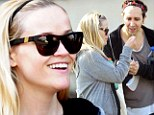 Wish upon a... flower? Reese Witherspoon giggles as she and her dance class pals make a wish upon a dandelion after an hour-long workout