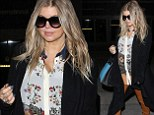 Daring: Pregnant Fergie donned leather hotpants as she arrived at LAX on Sunday