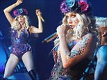 Flower power: Ke$ha crowns herself as the bad girl of pop with flower headdress as she performs in Atlantic City