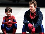 Mini-me: Andrew Garfield hangs out with his young co-star Jorge Vegas on a break from filming scenes for The Amazing Spider-Man 2 in New York on Sunday