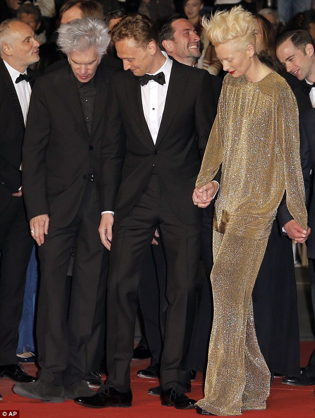 Taking it easy: From left, director Jim Jarmusch, actor Tom Hiddleston and actress Tilda Swinton arrive for the screening of Only Lovers Left Alive at the 66th international film festival