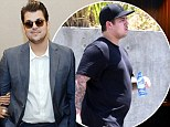 'I still have to lose 40 to 50 pounds': Rob Kardashian admits he has a long way to go as he shows off SLIGHTLY slimmer frame