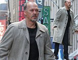 Man above town: Michael Keaton flies over Times Square...but it's just a scene for his new movie