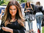 'She wants to look perfect': Khloe Kardashian flaunts her 25-pound weight loss in blue skinny jeans at sister Kim's house