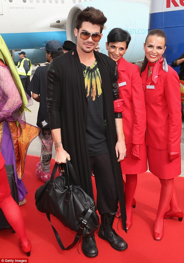 Glambert in transit: Adam Lambert stepped off the Life Ball plane from NY to Vienna looking reasonably relaxed ahead of his evening performance