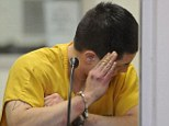 Suspect: Jerry Andrew Active tries to shield his face during his arraignment on charges of murder and sexual assault of a minor in the Anchorage jail court on Sunday