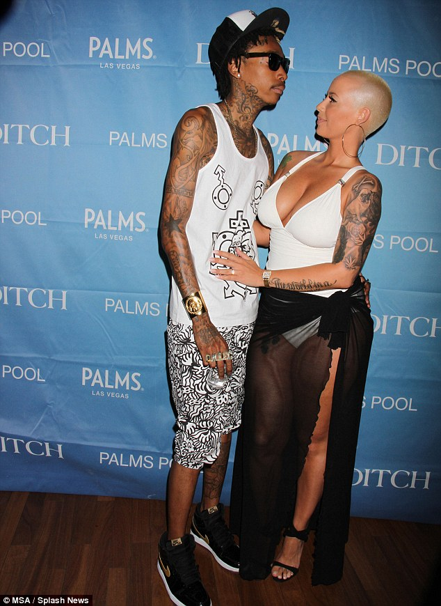 Couple in profile: Amber Rose stared deep into the sunglasses of Wiz Khalifa on Friday at the Palms Resort and Casino in Las Vegas