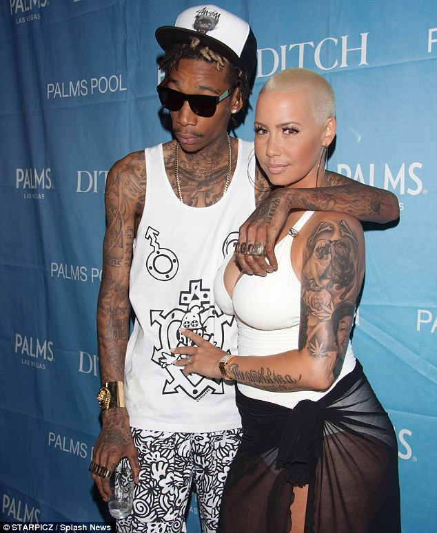 Inked up: Wiz and Amber both sport plenty of tattoos