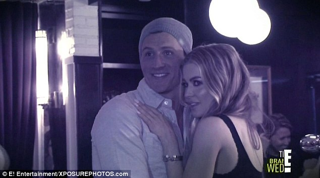 Slick moves: Ryan is seen here on a surprise date with Carmen Electra on the latest episode of his reality show What Would Ryan Lochte Do?