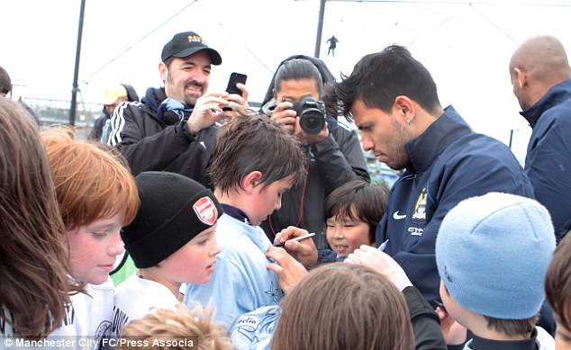 Popular figure: The Argentinian signs autographs for fans