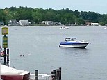 Wreck: The boat that caught fire this afternoon in Edgewater, Maryland that led to eight people being hospitalized
