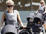 Supermom! Anna Paquin shows she can handle her own as she takes the twins out for a solo stroll in Ojai