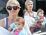 Makeup-free Elsa Pataky shows off flawless complexion while cuddling daughter India after dinner in Malibu