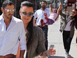 Swinging good time! Kyle Richards shows united front with husband Mauricio Umansky as they playfully suspend daughter Portia in the air on family outing