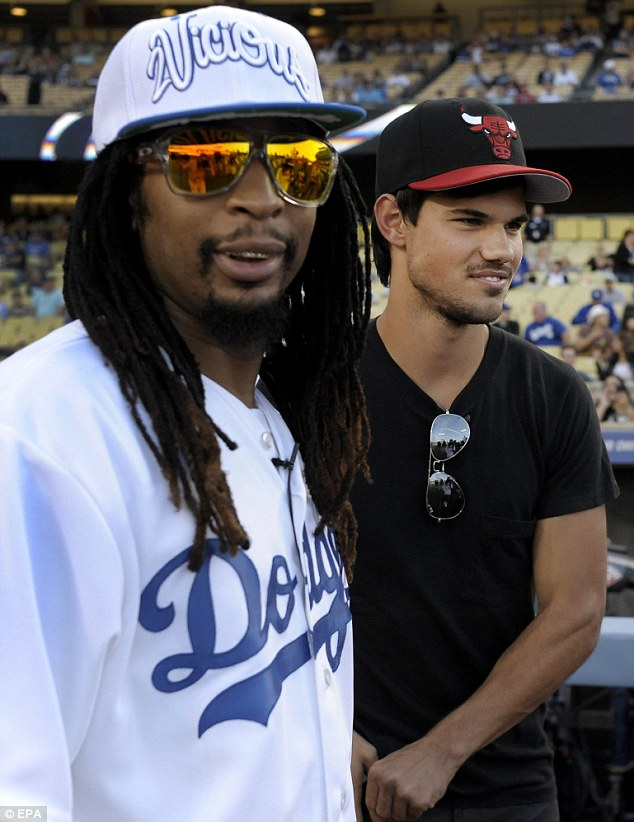 Odd couple: But the hip hop star obviously enjoyed being in the company of the silver screen hunk