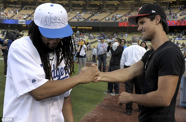 Thumb wrestle: Perhaps the dynamic duo were about to fight it out for the chance to throw first pitch