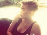 'Can't stop!' Miley Cyrus Instagrams sultry snap of herself bathed in golden light as she rocks a revealing black dress