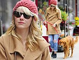 Boho chic! Emma Stone covers up in over-sized coat as she takes her and Andrew Garfield's pooch for a stroll