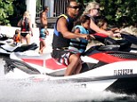 Holiday fun: Tiger Woods and his girlfriend Lindsey Vonn took his sons Sam, six, and Charlie, four, for a jet skiing outing on Monday in Florida