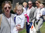 Just another casual Sunday! Eric Dane slouches around in sweatpants as he and wife Rebecca Gayheart carry their youngsters to a Beverly Hills birthday party