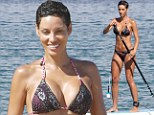 What a good sport! Nicole Murphy tries her hand at paddle-boarding as she struts around the shores of Maui in a lacy bikini with fiance Michael Strahan