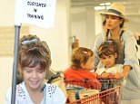 Mommy's little shopper! Jessica Alba's daughter Honor is a 'customer in training' as she pushes a mini trolley around the supermarket