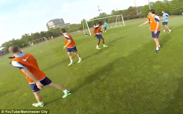 Heading towards us: Manchester City players train as they prepare to take on Chelsea in New York