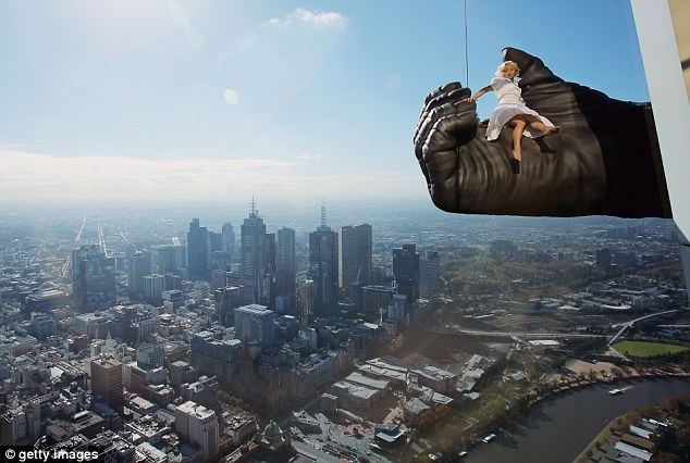 Vertigo: Stunt expert Leigh-Anne Vizer is held by a giant King Kong hand 300 metres above the city of Melbourne during a PR stunt