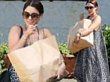 Ditching the diet? Vanessa Hudgens drowns her curves in billowing frock as she lugs HUGE bag of gourmet cheese