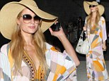 'Loving life!' Paris Hilton tweets gratefully as she lands in Los Angeles after four hour delay at Heathrow airport