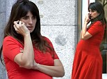 Looking red-dy to pop: Penelope Cruz shows off her huge bump in red dress as she awaits birth of second child