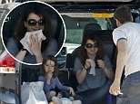 She doesn't need a fancy restaurant! Alyson Hannigan eats lunch from the trunk of her car with her husband and daughters