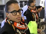 Can't always glam it up... Kerry Washington wore barely any make-up and sported a pair of nerdy plastic-rimmed glasses to Los Angeles International Airport on Monday