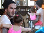 Skater girl! David Beckham's only daughter Harper has her sights set on a skateboard as retired footballer takes her and his son Brooklyn to Venice Beach