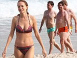 She wears it better! Hangover cast dons bikini bottoms in Rio but Heather Graham steals the show with her amazing beach body