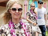 Aloha! Paris Hilton dons a floral girly dress as she and boyfriend River Viiperi finally arrive in Hawaii after disastrous trip back from Cannes