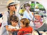 Mommy's little shopper! Jessica Alba's daughter Honor, four, is a 'customer in training' as she pushes a mini trolley around the supermarket