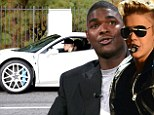 'Justin ran like a scared little child': Strapping NFL hero Keyshawn Johnson 'confronts Bieber over reckless driving'