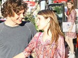 In need of some fashion tips? Emma Roberts clutches onto Cosmo as she steps out in a mismatched outfit for romantic date with boyfriend Evan Peters
