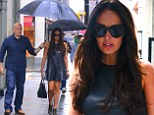 A brolly good fellow! Tamara Ecclestone is shielded from the rain in New York by umbrella toting minder