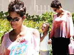 She's got that glow! Pregnant Halle Berry shows off luminous skin as she fetches Nahla from school