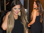 Sensational! Khloe Kardashian continues to steal the spotlight from Kim as she slips her trimmer figure into a tight black dress