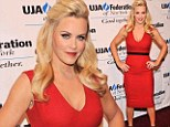 Lady in red: Jenny McCarthy posed on the red carpet on Tuesday at the UJA-Federation of New York awards dinner in New York City