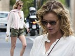 Eva Herzigova shows she's regained her slimline model figure just weeks after giving birth as she steps out in short shorts