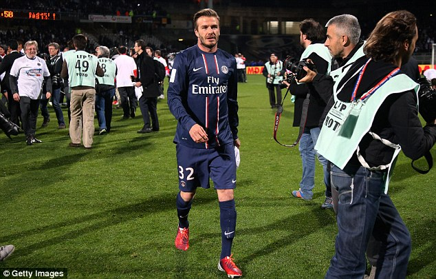 Tears: An emotional Beckham walks off the pitch after PSG's title win on May 13