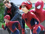 Spidey and little friend: Andrew Garfield as Spider-Man and Jorge Vegas as a miniature version enjoyed themselves on Monday while shooting on the set of The Amazing Spider-Man 2 in New York City