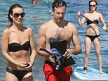 Another day in paradise! Olivia Wilde puts her washboard tummy on display during an active beach day with fiance Jason Sudeikis
