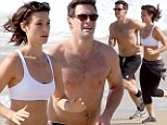 His girl in Ipanema! Justin Bartha and fiancée Lia Smith are off to a running start as they show off their beach bodies on a jog in Rio
